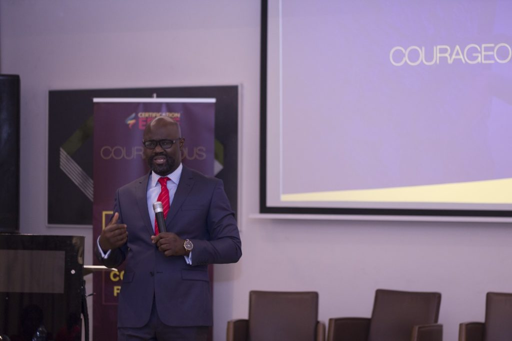 A man in Suit Speaking at Certification Edge the best preparatory certification exam centre